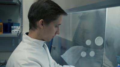 Daniel Szulc is performing cell culture work