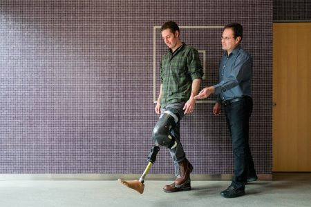 Jan Andrysek with patient testing out a prosthetic leg
