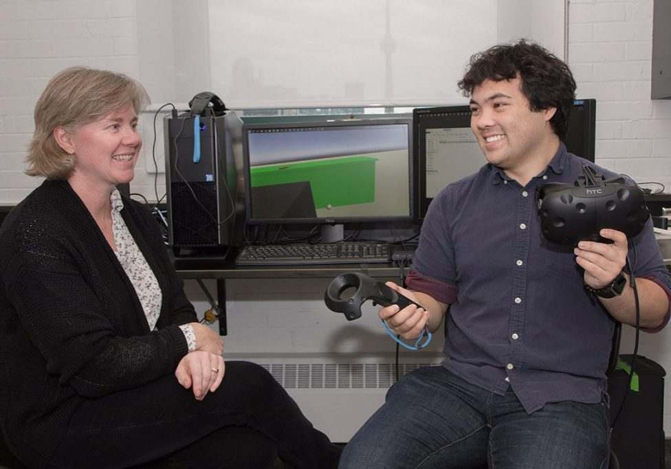 Alexander Sullivan and Dawn Kilkenny testing out the HTC Vive device