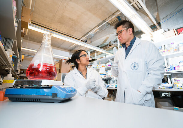 Warren Chan in a lab with a graduate student