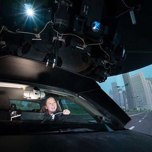Professor Geoff Fernie and PhD candidate Philippa Gosine use the DriverLab simulator