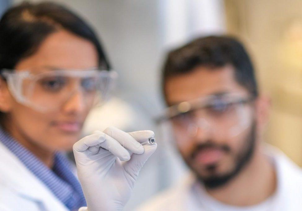 IBBME researchers Buddhisha Udugama (left) and Pranav Kadhiresan (right) hold a miniaturized lithium heater. (Photo: Qin Dai)