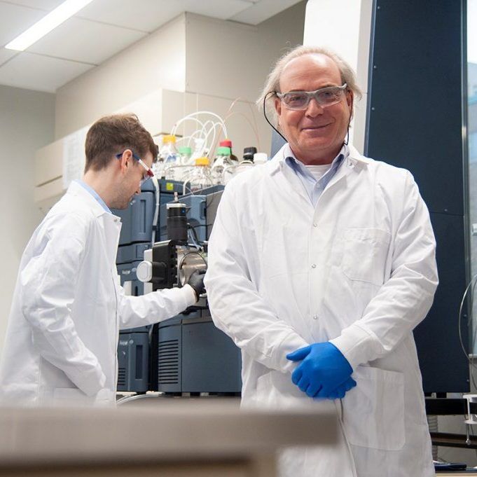 Yoav Finer and Cameron Stewart in a lab