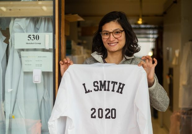 Laura Smith holding her lab coat